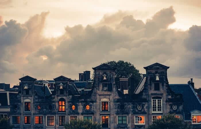 Images of rooftops along amsterdam canal to illustrate where to stay in amsterdam