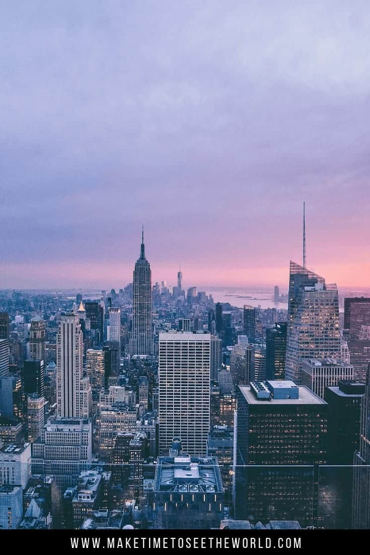 Things To Do in NYC pin image - aerial shot of the New York skyline at dusk