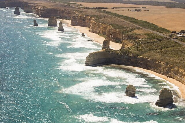 Aerial shot of the famous 12 apostles and great Ocean road on Victoria's coast.