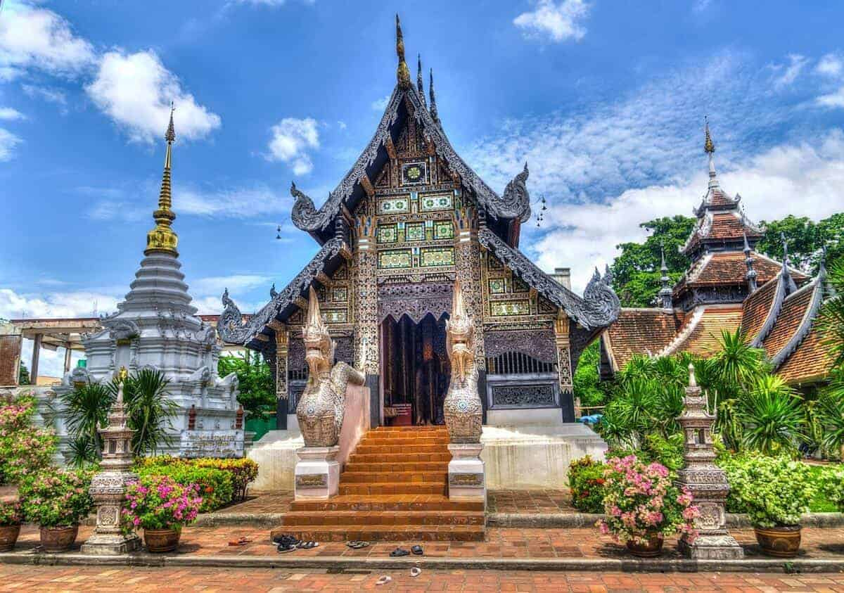 Things to Do in Chiang Mai Travel Guide Cover Image of Temple but blue sky background