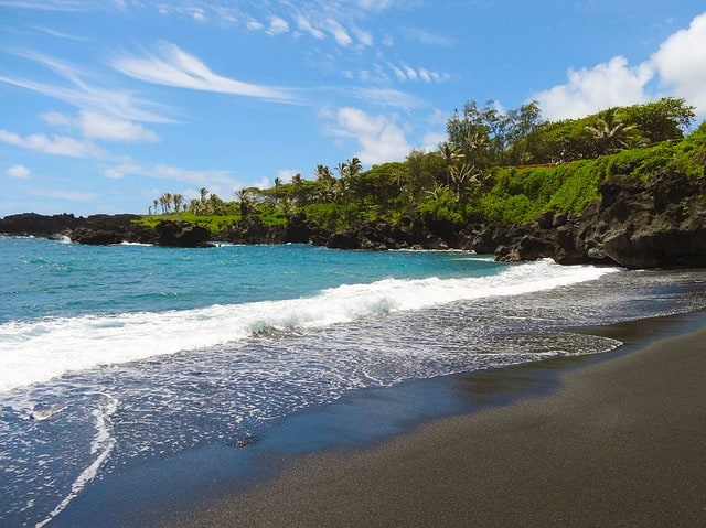 Things to do in Hawaii - visit the Black Sand Beaches along the coast of Hawaii