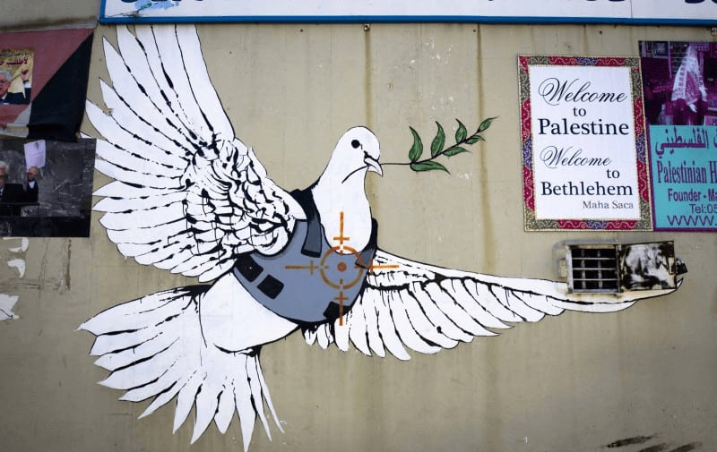 Dove of Peace Under Threat - Banksy in Bethlehem