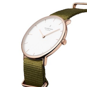 Olive green watch strag with gold hardware and watch face trim with a white watch face.