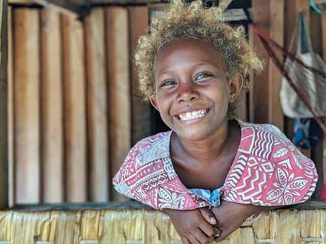 Young Solomon Islander smiling with amazing blond Afro