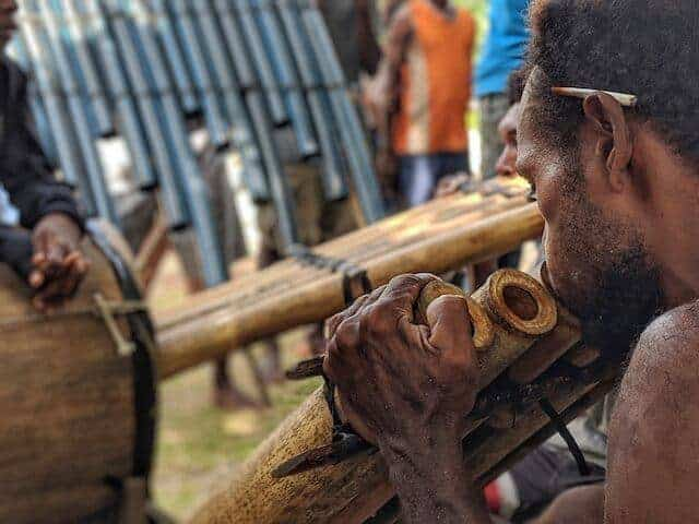 Solomon Island Man playing the pan pipes