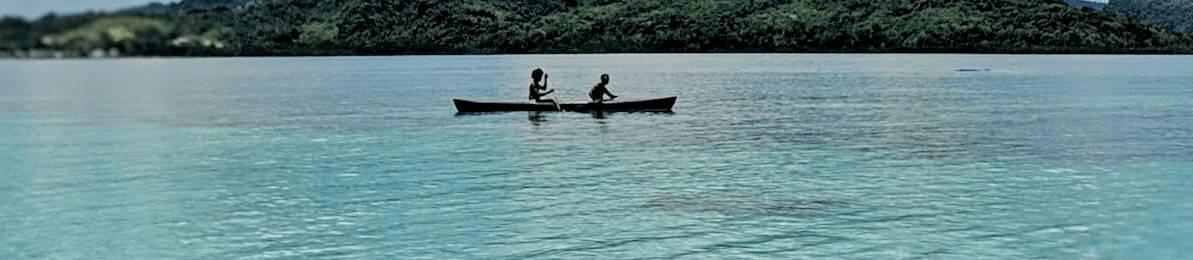Solomon Islands People - Two People of Solomon Islands in a Canoe