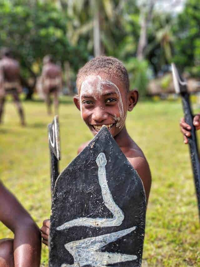 Young Boy Warrior Cheeky Smile at Karomulun Village