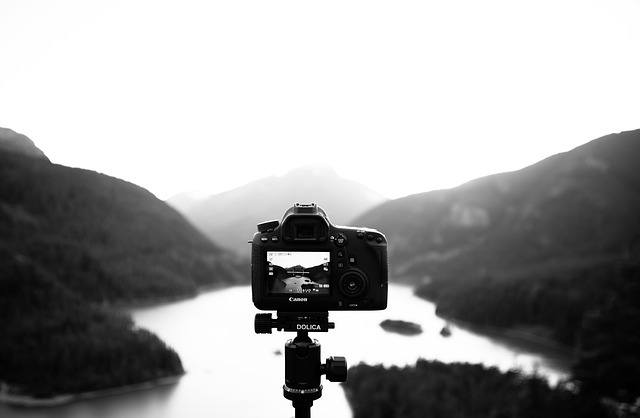 The Best Travel Tripods on the Market - Tripod with Camera looking out on the landscape