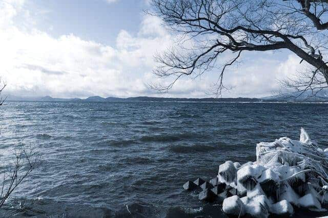 Lake Inawashiro with ice crust across the breakers