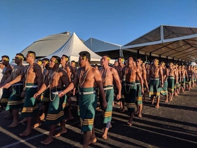 Samoan shirtless men walking in a parade to celebrate Samoan Independence