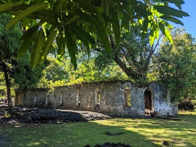 View of the ruins of the church surrounded by solid lava at the Saleaula Lava Fields in Samoa