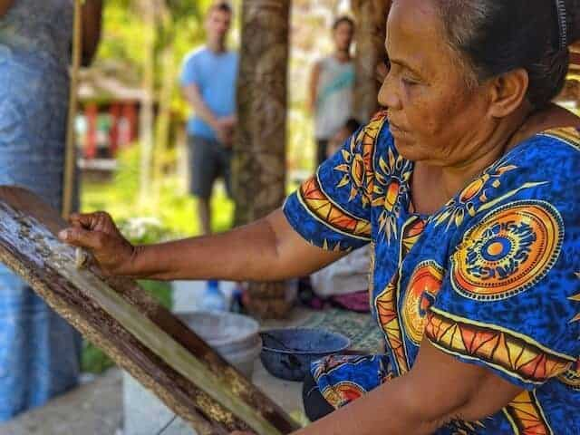 Lady making paper in a traditional way in Samoa