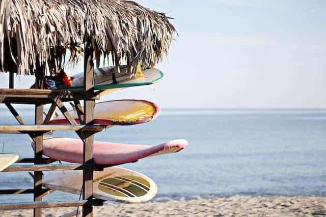 Surfboards in a rack on the beach