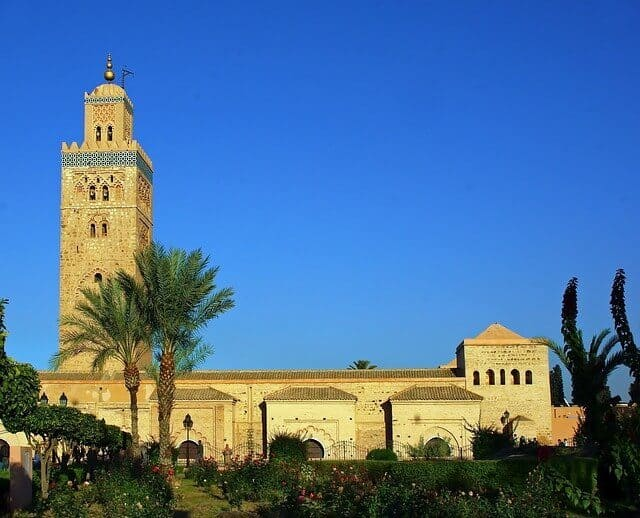 side view of the koutoubia mosque marrakech with a blue sky backdrop