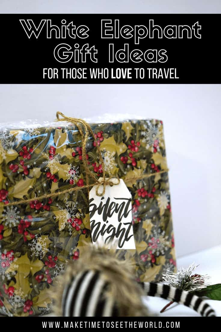 Pin Image with the title: White Elephant Gift Ideas for those who love to travel overlayed on an image of a square wrapped gift with a tag saying silent night and a pair of zebra striped earmuffs with a christmas bow on them at the front of the shot