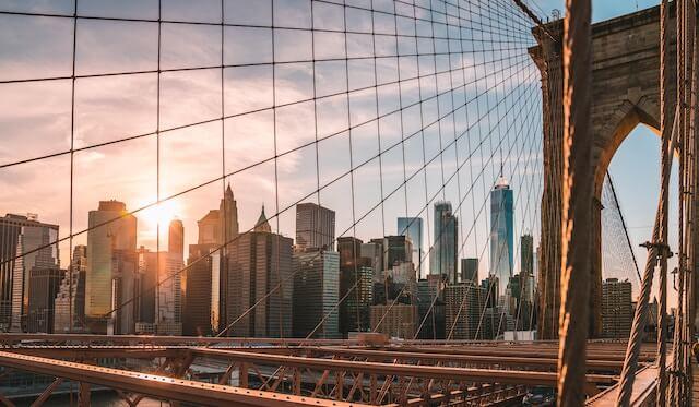 Sunrise through the wires of the Brooklyn Bridge New York