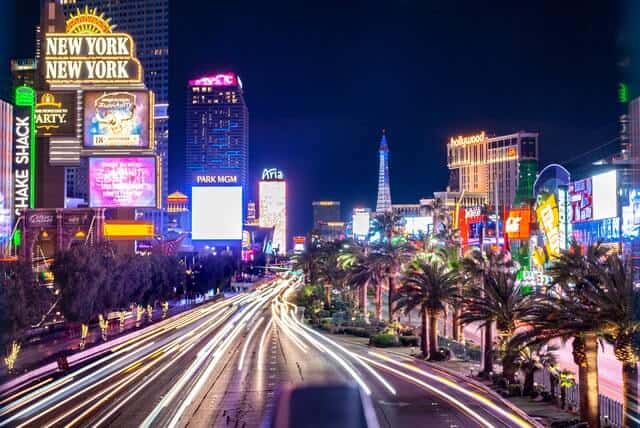 Las Vegas Strip Nevada with light trails down the street iself, hotels lit up either side