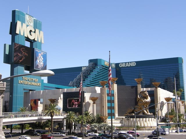 Large Emerald Green Building of the MGM Grand Las Vegas guarded by a giant Gold Lion