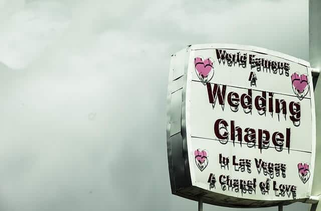 Little White Wedding Chapel neon sign in day time