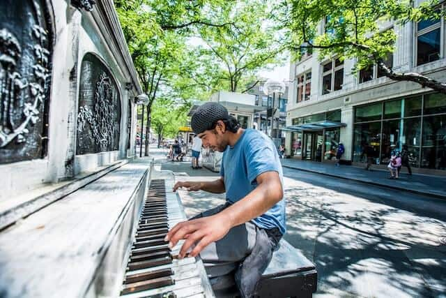 16th Street Mall Denver with man playing one of the street pianos