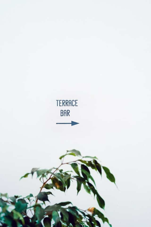 Hang out on rooftop bar in Melbourne terrace sign