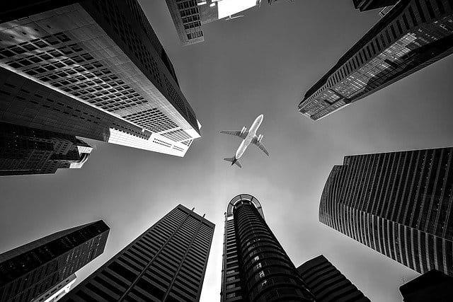 Plane in the Sky between buildings