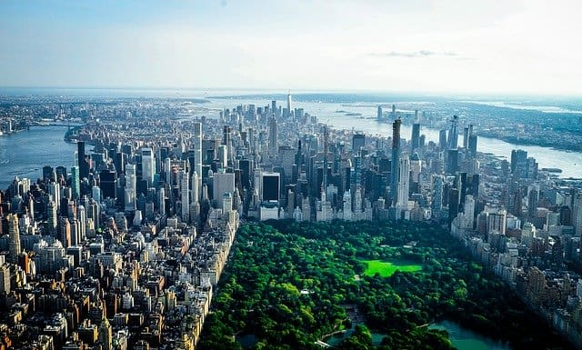 Manhattan from above with Central Park fringed by skyscraper buildings