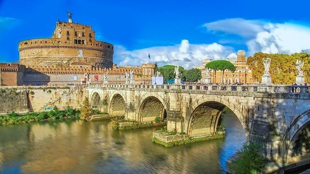 A Bridge adorned with regigious statues leading to Castel SantAngelo in Rome Italy