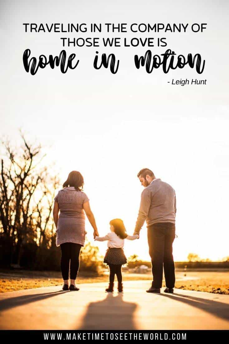 A mother and father stand either side of their little girl, each holding her hand in the middle of the road with the text overlay: Traveling in the company of those we love is home in motion