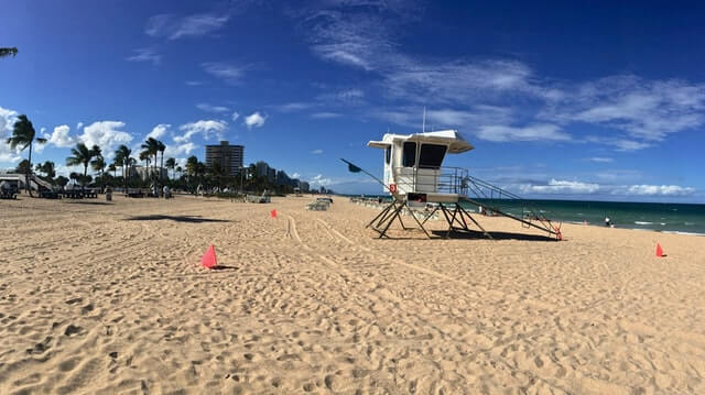 White wooden lifeguard station on the beige sands of Fort Lauderdale Beach