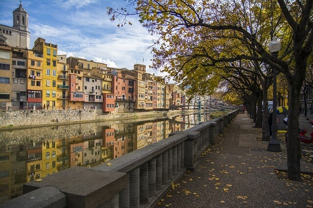 Colourful houses lining the river in Girona