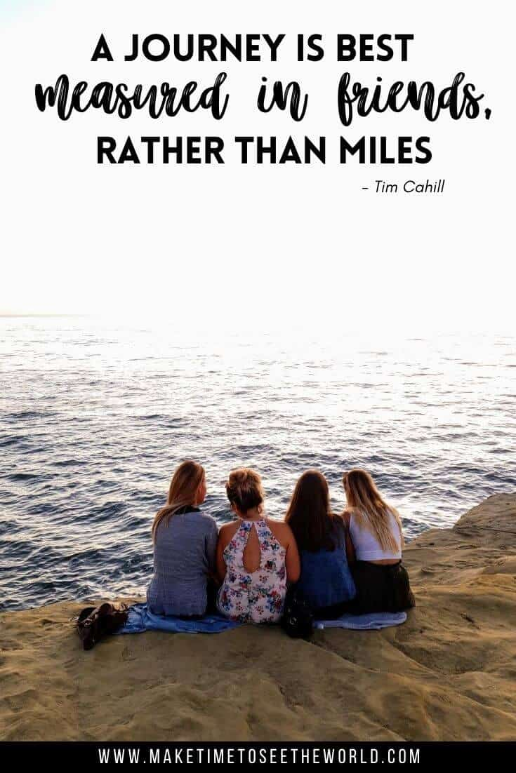 4 Female firends sat in a line with their backs to the camera on a cliff top overlooking the ocean with text overlay staing: A Jourey should be measured in friend rather than miles