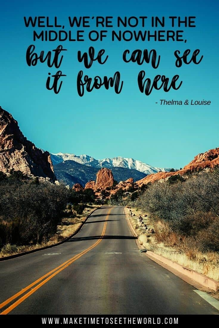 Road trip quote from Thelma and Louise: Well, we're not in the middle of nowhere, but we can see it from here overlayed on an image of a road with cliffs either side leading to red rocks in the distance and snow capped mountains behind the rocks