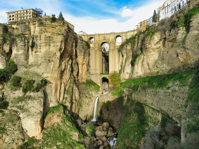 Looking up towards the famous 3 arch bridge of Ronda Spain - one of the best places to visit in Spain