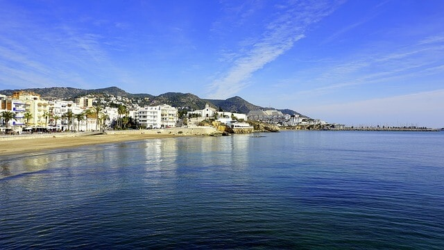 view of the beachside town Sitges from the water