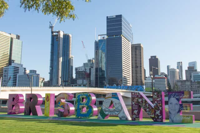 Colourful Brisbane Sign with the city skyline in the background