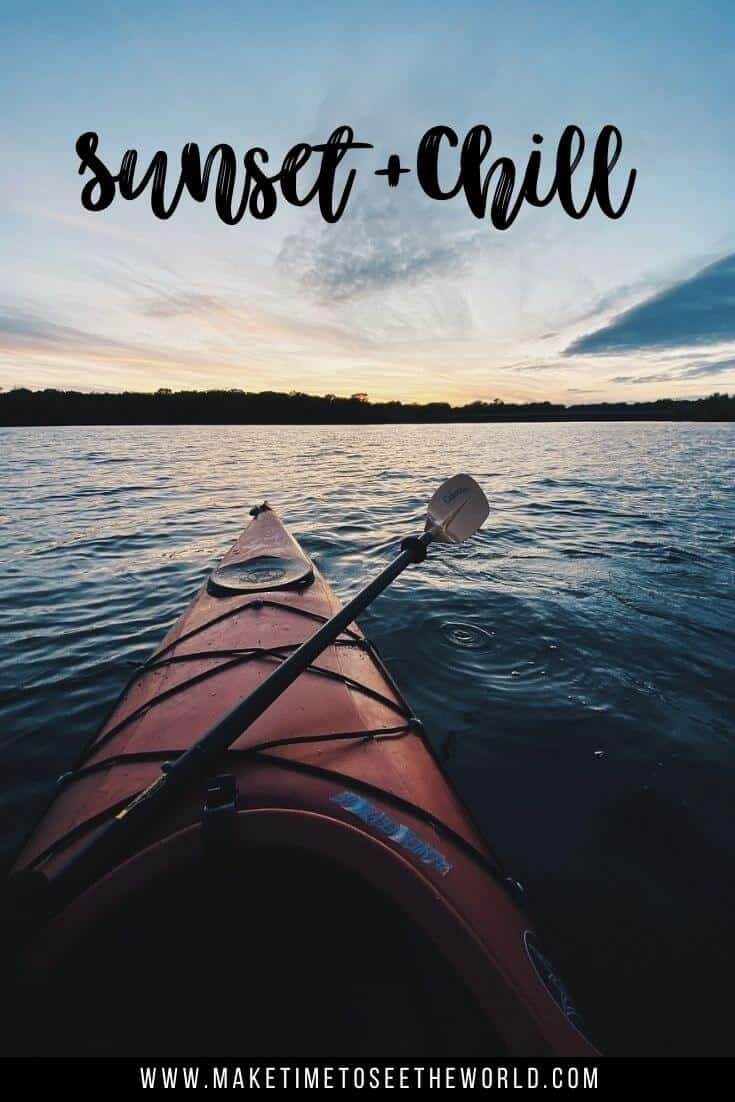 Sunset & Chill (text overlay) of a red kayak on the water with a paddle lying across the kayak
