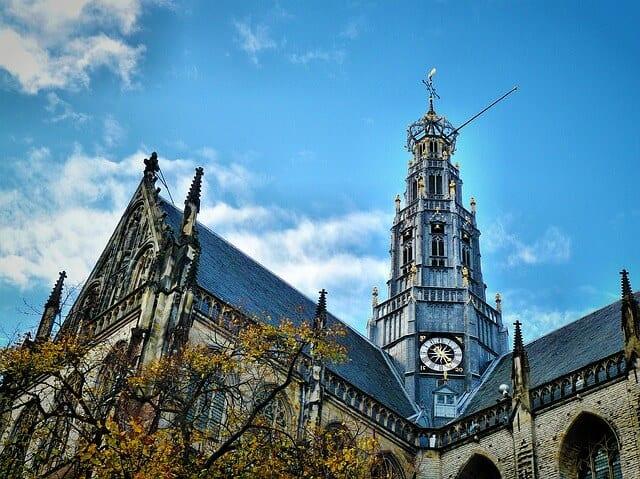 Looking up towards the main spire of the Church - De Grote of St. Bavokerk Te