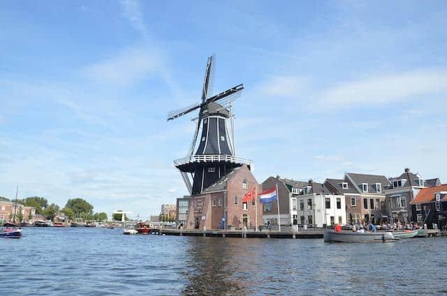 Windmill on the riverbank known as Molen de Adriaan in Haarlem Netherlands