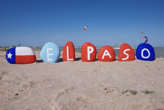 Painted rocks in the desert with El Paso painted a letter on each rock