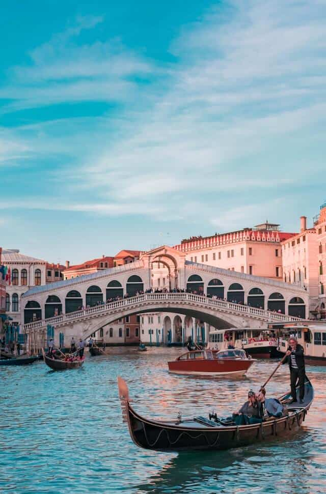 Gondola on the grand canal in Venice with the Rialto Bridge in the Background