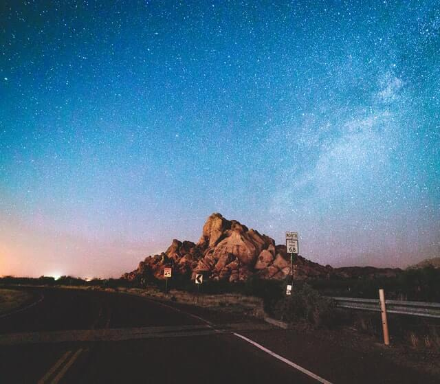 Hueco Tanks State Park & Historic Site as viewed from the road at night under the Milky Way