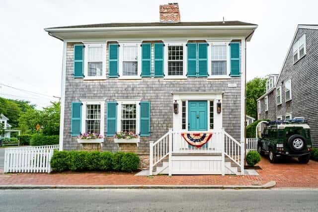 Stunning Double storey hose with turquoise shutters, white windows and raised galley entryway