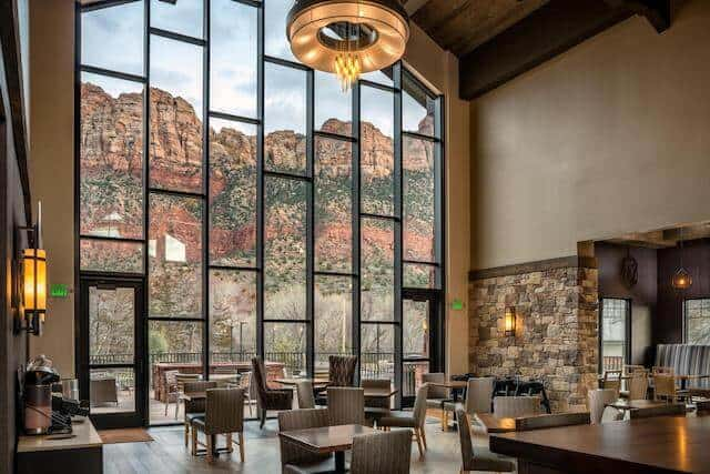 Three story windows looking out on the mountains of Zion National Park in the dining room of Springhill Suites by Marriott