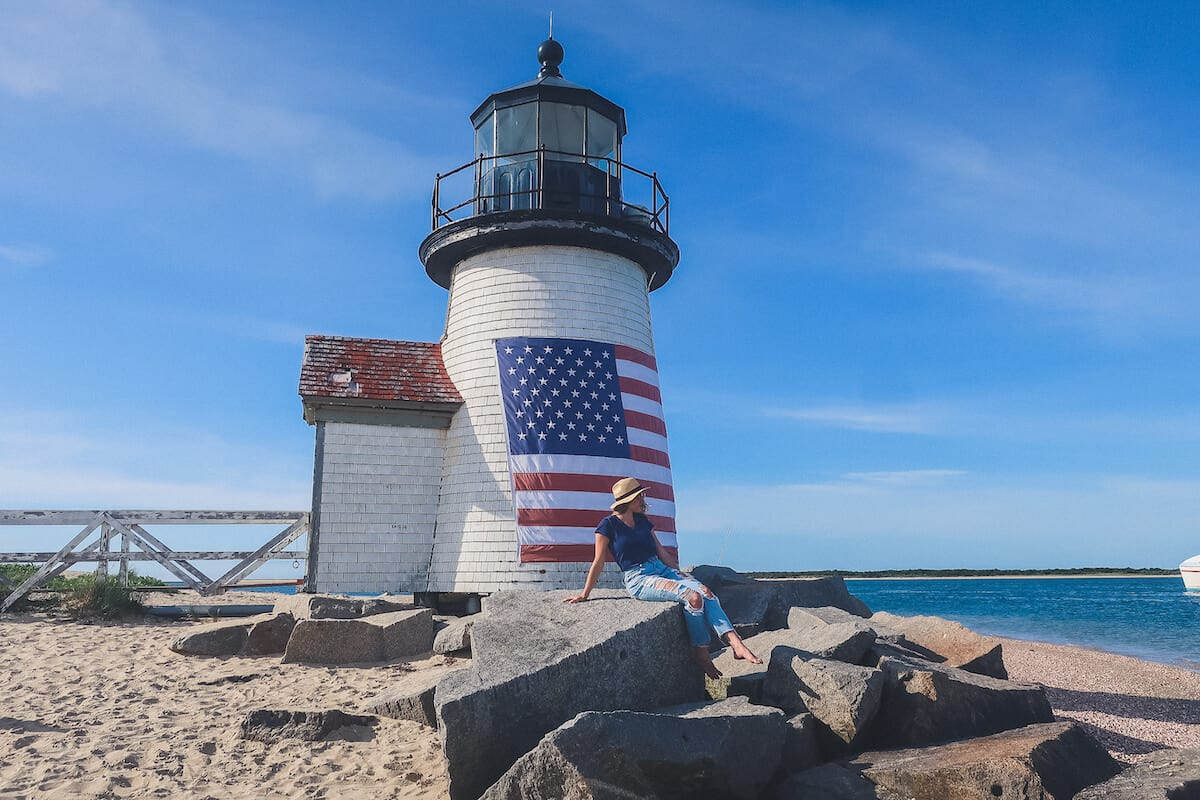 Things to do in Nantucket - Brant Point Lighthouse - Cover image of the lighthouse on the sand with the ocean in the background