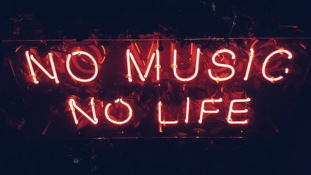 "Neon sign against a black wall saying ""No music no life"""