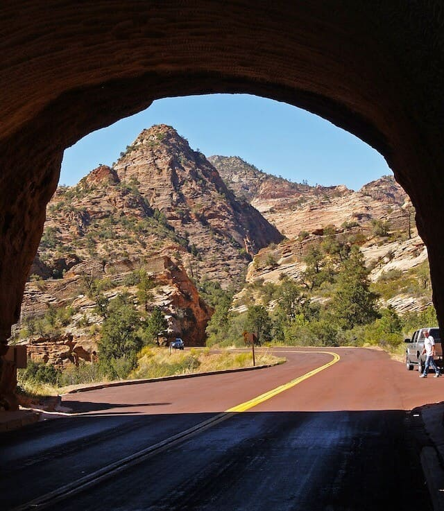 Tunnel exit looking out onto the rocky peaks of Zion National Park on the Zion-Mount Carmel Highway