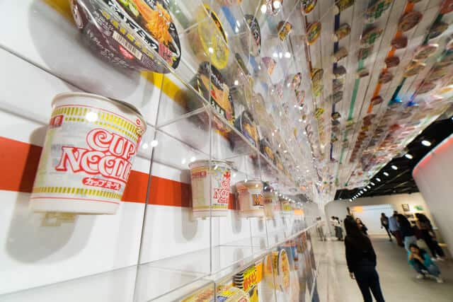 Different types of Cup Noodles on the wall at the Cup Noodle Museum