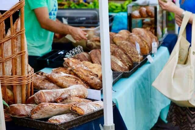 Fulton Street Farmers Market stall of freshly baked loaves of bread