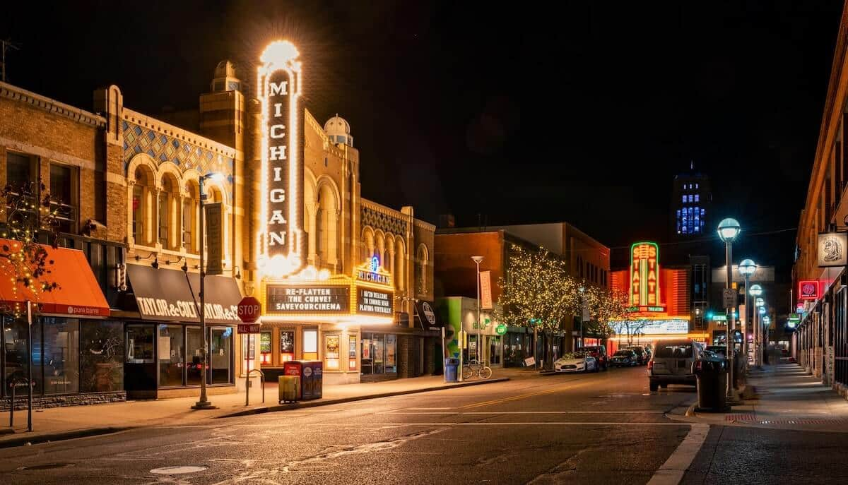 Fun Things to do in Ann Arbor Michigan header photo of the main street at night, the state theater lit up in the centre